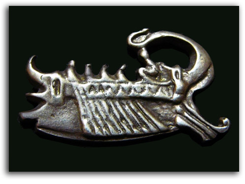 Image of brooch in shape of a ship.